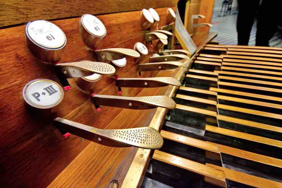 Picture of the bottom of an organ with lots of pedals